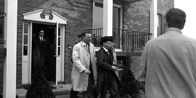 UNITED STATES - MARCH 21: Winston Moseley in police custody after surrendering to an FBI agent in a Buffalo...