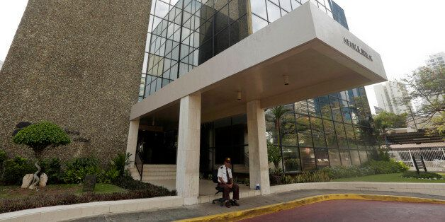 A security guard sit outside the Mossack Fonseca law firm in Panama City, Sunday, April 3, 2016. German...