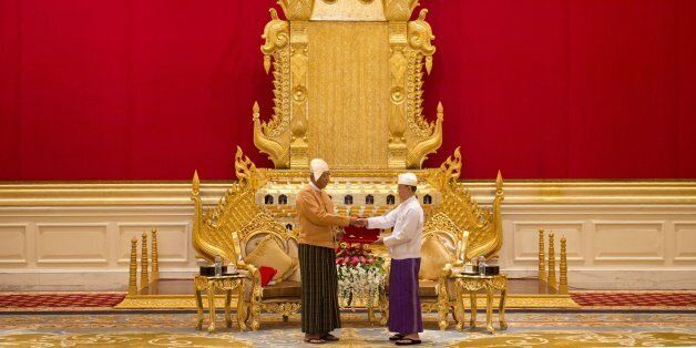 New Myanmar President Htin Kyaw (L) receives the presidential seal from outgoing president Thein Sein...