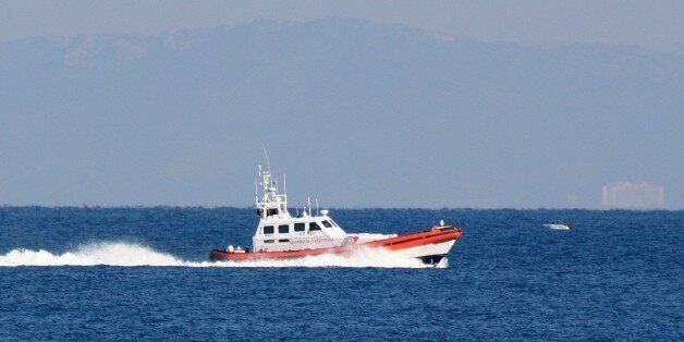 An Italian vessel from the European border agency Frontex assists the Greek Coast Guard in the search...