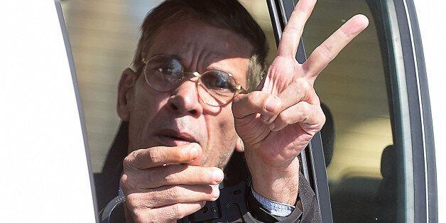 Handcuffed Seif al-Din Mohamed Mostafa, an Egyptian man who hijacked an EgyptAir passenger plane the...