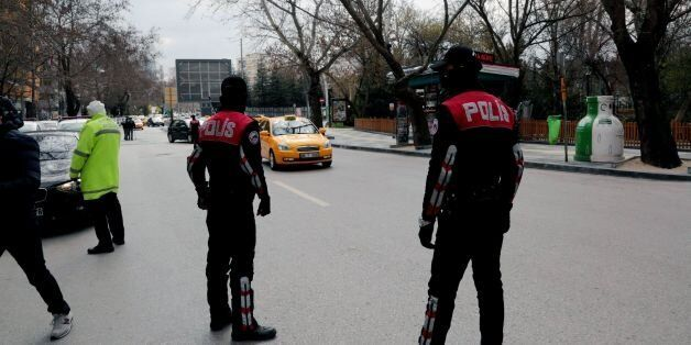 Security officials check cars in Ankara, Turkey, Thursday, March 17, 2016.A radical Kurdish group with...