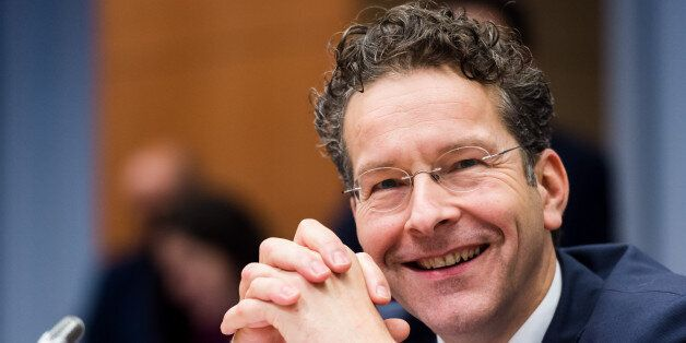 Dutch Finance Minister and chair of the eurogroup finance ministers Jeroen Dijsselbloem smiles as he...