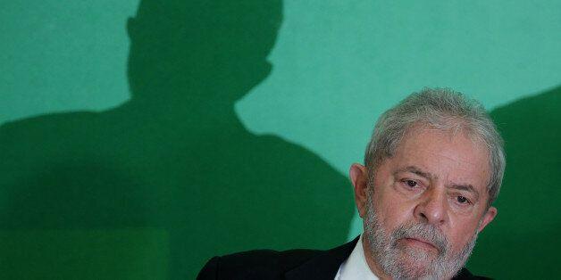 Brazil's former President Luiz Inacio Lula da Silva attends his swearing-in ceremony as the chief of...