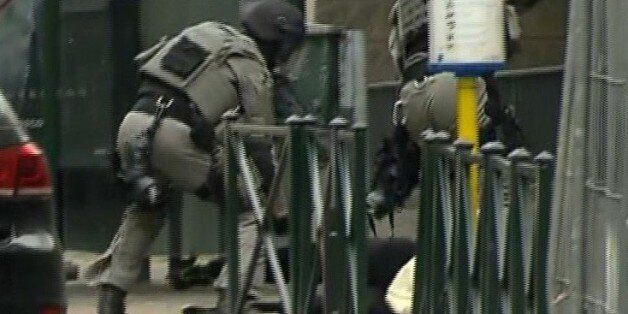 ADDING IDENTITY OF MAN IS CONFIRMED TO BE SALAH ABDESALAM - In this framegrab taken from VTM, armed police...