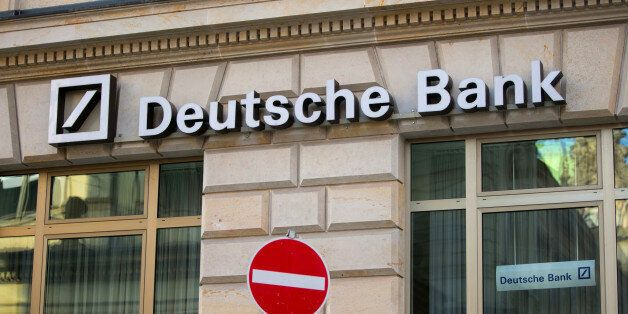 Deutsche Bank AG signage sits on the facade of a branch above a no entry sign, in Hamburg, Germany, on...