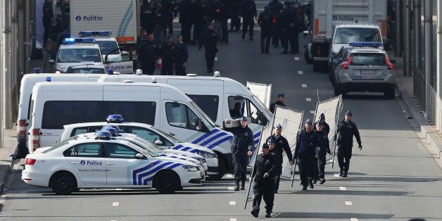 BRUSSELS, BELGIUM - MARCH 22: Soldiers, police officers and medical personnel attend the scene at the...