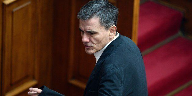 Greek Finance Minister Euclid Tsakalotos attends a committee meeting in the Greek parliament in Athens...