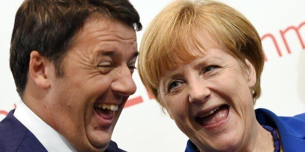 German Chancellor Angela Merkel (R) and Italian Prime Minister Matteo Renzi smile during the 10th Asia-Europe...