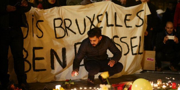 BRUSSELS, BELGIUM - MARCH 22: People hold up a banner as a mark of solidarity at the Place de la Bourse...