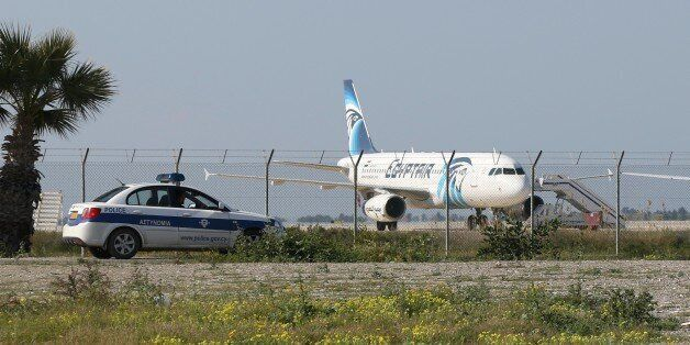 An Egypt Air Airbus A-320 sits on the tarmac of Larnaca aiport after it was hijacked and diverted to...