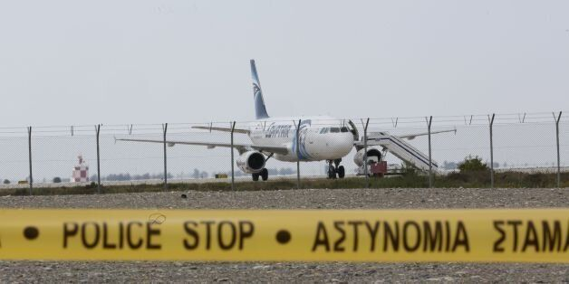 Cypriot security forces cordon off the area around Larnaca airport where an EgyptAir Airbus A-320 (C)...