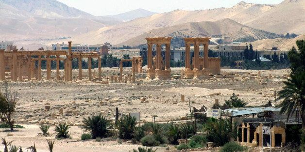 File-This file photo released on Sunday, May 17, 2015, by the Syrian official news agency SANA, shows...