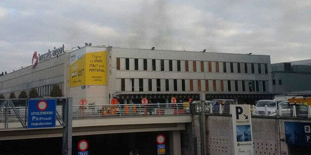 In this image provided by Daniela Schwarzer, smoke is seen at Brussels airport in Brussels, Belgium,...
