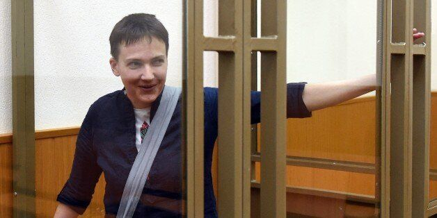 Ukrainian military pilot Nadiya Savchenko looks out from a defendants' cage after the first day of the...