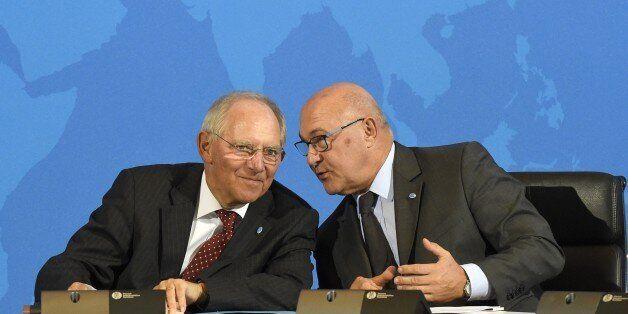(LtoR) German Finance Minister Wolfgang Schaeuble and French Finance Minister Michel Sapin chat during...
