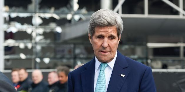 US Secretary of State John Kerry attends a ceremony at the Brussels National Airport to pay tribute to...