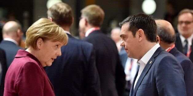 German Chancellor Angela Merkel, left, talks with Greek Prime Minister Alexis Tsipras, right, during...