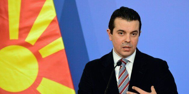 Macedonian Foreign Minister Nikola Poposki answers to journalists during the joint press conference with...