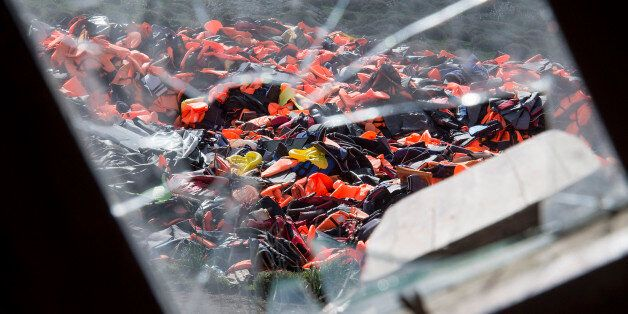 MITHYMNA, GREECE - MARCH 10: Hundreds of used life vests lie on a makeshift rubbish dump hidden in the...