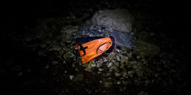 MYTELENE, GREECE - MARCH 09: A life vests floats in the water after an inflatable boat with refugees...