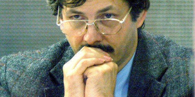 Marc Dutroux looks out from behind protective glass during a court session at the Palace of Justice in...