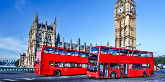 Famous Big Ben with red buses in London, England,