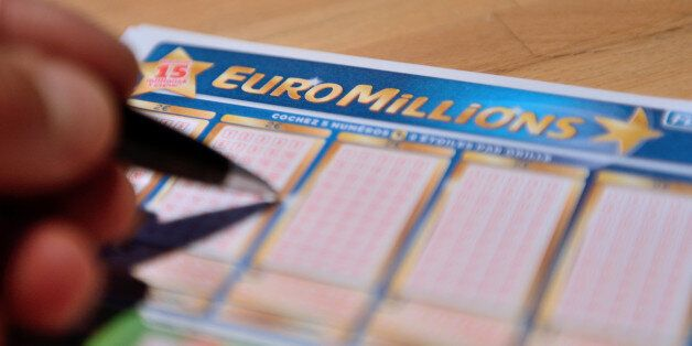 A person fills an Euro Millions lottery ticket, on June 21, 2013 in Lille, northern France. No player...