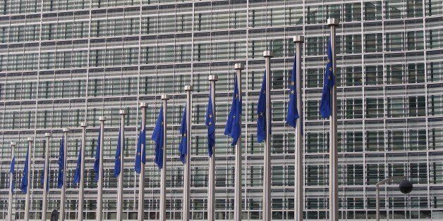 There are many EU flags in front of the European Commission building in Brussels. The building is huuuuge....