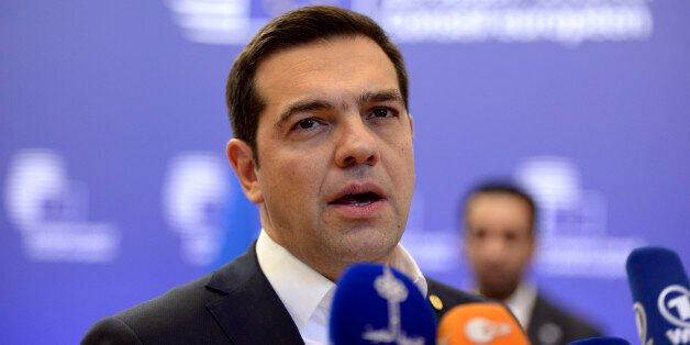 Greek Prime Minister Alexis Tsipras talks to the media at the end of the European Summit in Brussels...