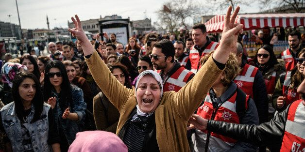 A Turkish woman gives a V sign during a march in the Kadikoy district of Istanbul to mark International...
