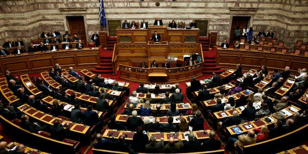 Greece's Prime Minister Alexis Tsipras addresses lawmakers during a parliamentary session in Athens,...