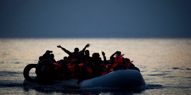 MYTELENE, GREECE - MARCH 09: An inflatable boat is seen while arriving at the shore, crossing the sea...
