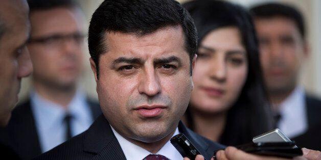 Turkish co-chairman of pro-Kurdish People's Democratic Party, or HDP, Selahattin Demirtas speaks with...