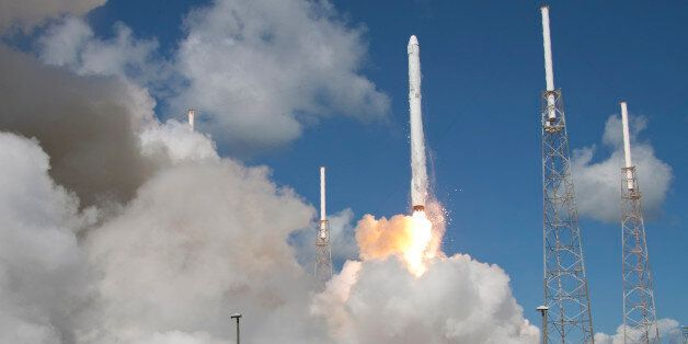 The SpaceX Falcon 9 rocket and Dragon spacecraft lifts off from Space Launch Complex 40 at the Cape Canaveral...