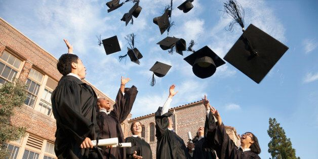 Graduates throwing hats in the