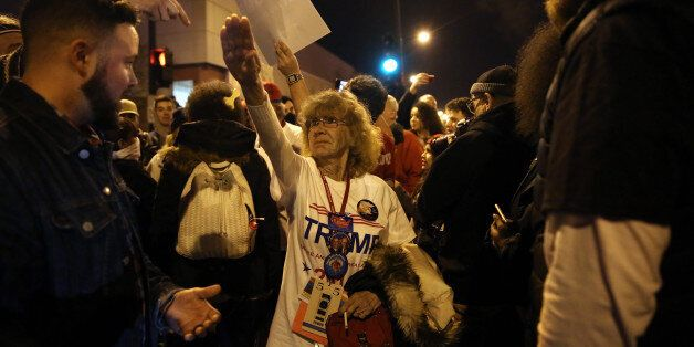 Donald Trump supporter Birgitt Peterson of Yorkville, Ill., argues with protesters outside the UIC Pavilion...