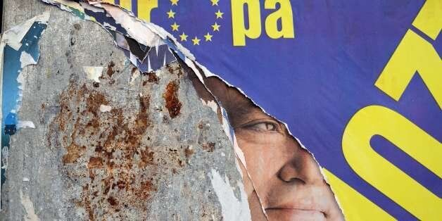 A banner of an Italian candidate for the European Parliament elections is seen on a wall in Rome on May...