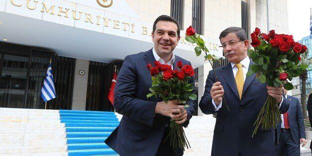 IZMIR,TURKEY - MARCH 08: Turkish Prime Minister Ahmet Davutoglu (right) welcomes Greek Prime Minister...