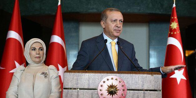 His wife Emine Erdogan stands asTurkish President Recep Tayyip Erdogan addresses a reception at the presidential...