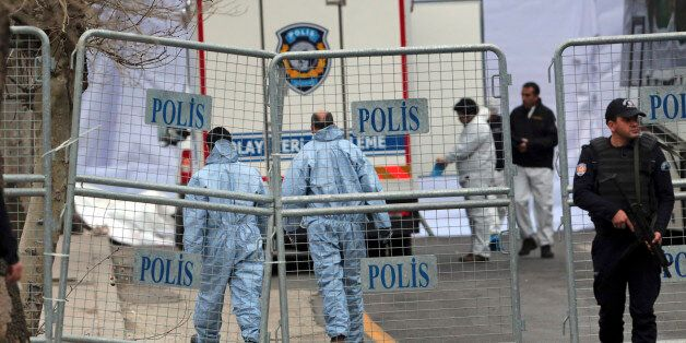 Security and forensic officials work at the site of Sunday's explosion in the busy center of Turkish...