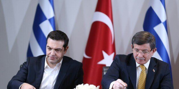 IZMIR, TURKEY - MARCH 08: Turkish Prime Minister Ahmet Davutoglu (R) and Greek Prime Minister Alexis...