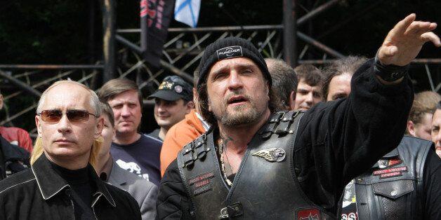 Russian Prime Minister Vladimir Putin, left, and leader of Nochniye Volki (the Night Wolves) biker group,...