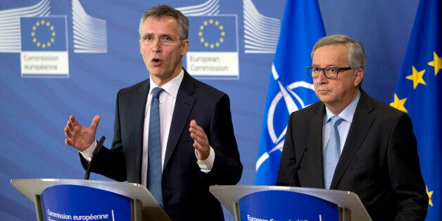 NATO Secretary General Jens Stoltenberg, left, participates in a media conference with European Commission...