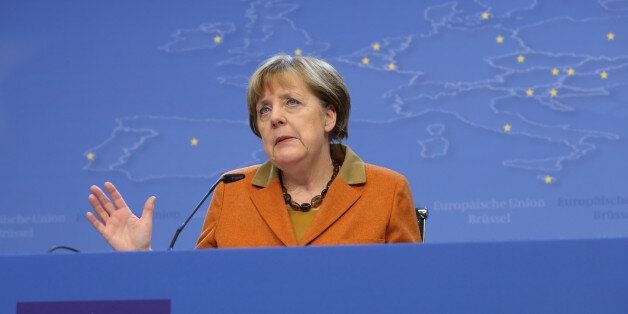 German Chancellor Angela Merkel gestures while speaking during a media conference at an EU summit in...