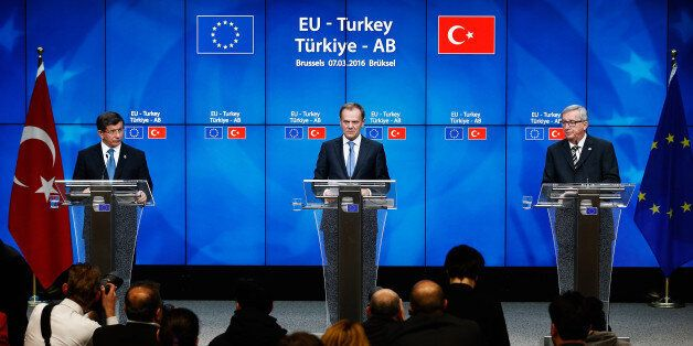 BRUSSELS, BELGIUM - MARCH 07: European council president, Donald Tusk (C) and Turkish Prime Minister...