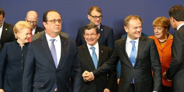 BRUSSELS, BELGIUM - MARCH 7: Turkish Prime Minister Ahmet Davutoglu (C), French President Francois Hollande...