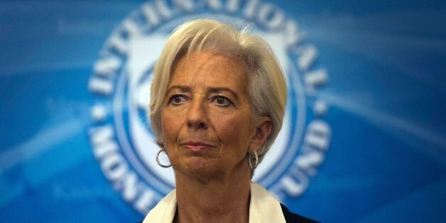IMF Managing Director Christine Lagarde smiles during a press conference at the International Monetary...
