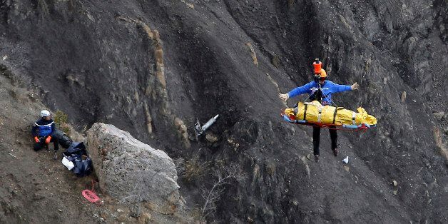 FOR USE AS DESIRED, YEAR END PHOTOS - FILE - A rescue worker is lifted into an helicopter at the crash...