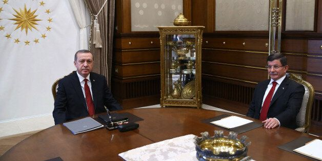 Turkish President Recep Tayyip Erdogan, left, and Prime Minister Ahmet Davutoglu attend a a meeting at...